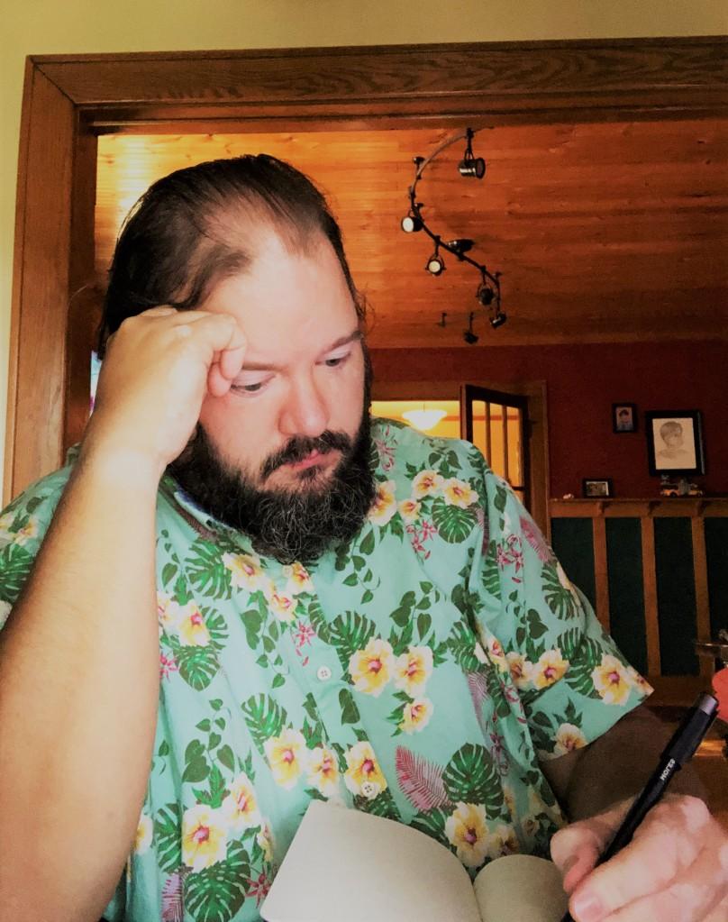 A man sitting at a desk writing about nonsense